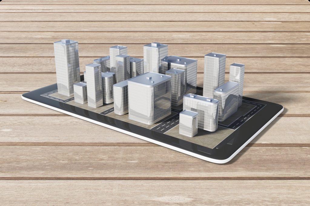 Ein Smartphone liegt auf einem Tisch. Auf dem Smartphone ist eine 3D-Stadt zu sehen